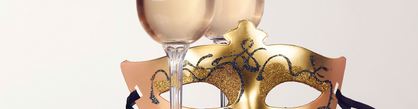 Carnival mask and glasses with champagne  on white background